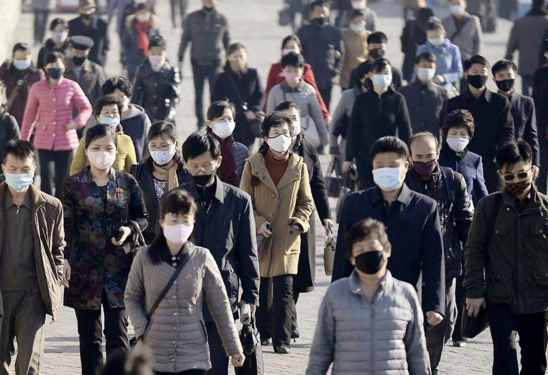 People wearing protective face masks commute amid concerns over the new coronavirus disease (COVID-19) in Pyongyang, North Korea March 30, 2020. (Kyodo/via Reuters)