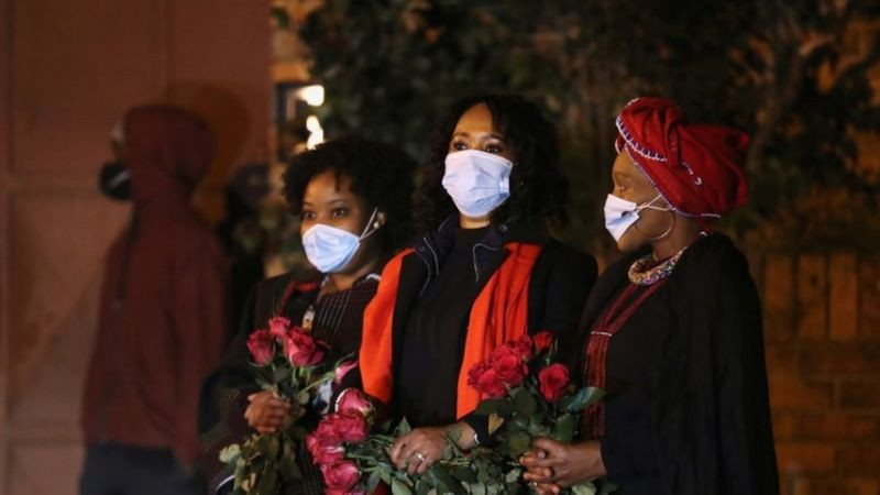 Mourners are seen as the funeral procession carrying the body of Zindzi Mandela