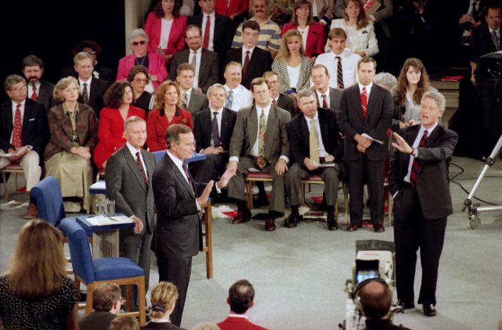 Bill Clinton, right, at the presidential debate in Richmond, Va., on Oct. 15, 1992, with Ross Perot and President George H.W. Bush. (Steve Helber/AP)