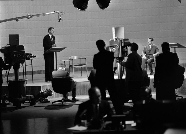 John F. Kennedy, left, speaks during a debate with Richard Nixon, seated, on Sept. 26, 1960, in Chicago. (CBS via Getty Images)