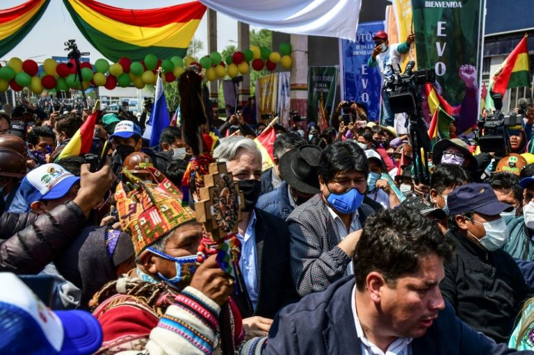 Hundreds of people had been waiting since dawn to greet Morales (center, right) as he returned to Bolivia on November 9, 2020