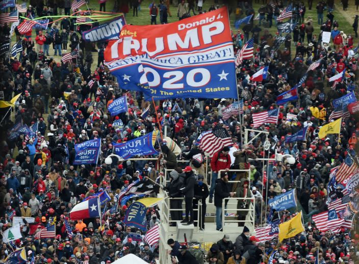 Supporters of President Donald Trump take over stands set up for the presidential inauguration as they protest at the US Capitol in Washington, DC on January 6, 2021. (Olivier Douliery/AFP via Getty Images)