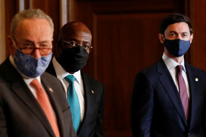 Senate Majority Leader Chuck Schumer (D-NY) delivers remarks with freshman U.S. Senators from Georgia Raphael Warnock (D-GA) and Jon Ossoff (D-GA) during a photo-op on Capitol Hill in Washington, U.S., January 21, 2021. (Tom Brenner/Reuters)