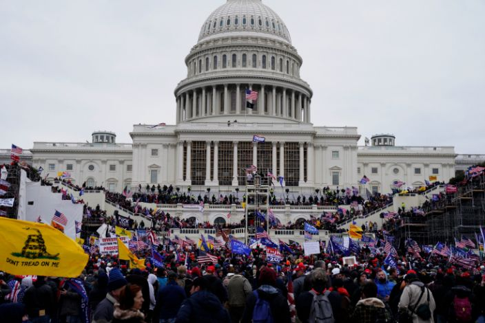 <p>Trump supporters storming the Capitol last Wednesday</p> (EPA)